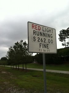 Strict enforcement aims to deter motorists from running red lights, Orlando, Fla; photo credit: MKHyde